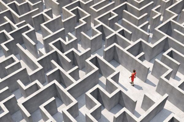 A woman walks through a maze