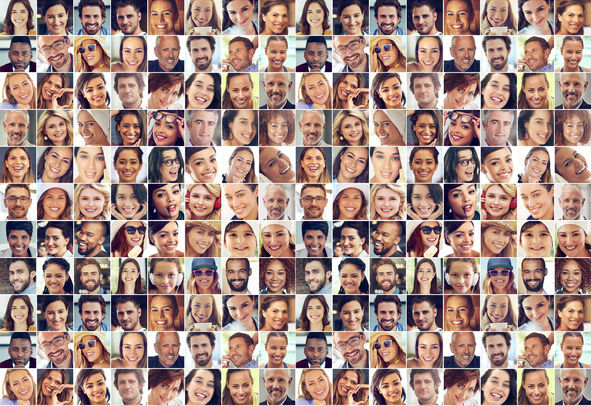 Composite image of a large group of diverse people smiling