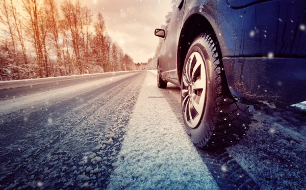 car on winter road in the morning