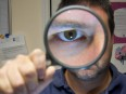 magnifying glass look for clues