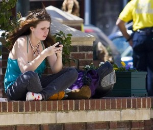 texting young woman student smart phone
