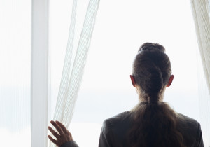 Bigstock_ 22654394 - Silhouette Of Business Woman Looking Into Window