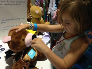 Child feeds new Jerry the Bear prototype.