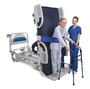 Standing hospital bed has patients on their feet, both in and out of bed