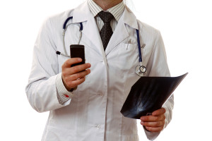 bigstock-Male-doctor-on-the-phone-in-a--39352393