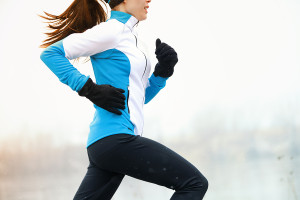 running athlete woman winter jogging