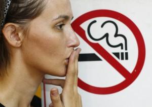 Lady smoking a non-smoking panel