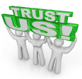 bigstock-Trust-Us-words-lifted-by-team--35567891