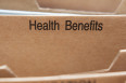 Health Insurance Benefits section tab in folding file.